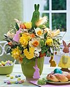 Easter arrangement of narcissi and tulips in green vase
