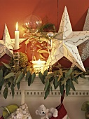 Christmas decorations with stars & candles on mantlepiece