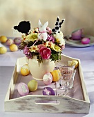 Tray with vase of Easter flowers and Easter eggs
