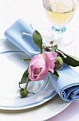 Place setting with fabric napkin and peony