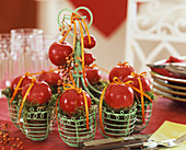 Wire wreath with red apples and moss