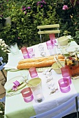 Laid table with baguettes and punch in the open air