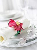 A place setting with napkin and napkin ring