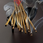 Incense sticks in dish