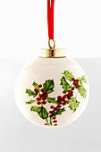 White Christmas bauble with holly motif
