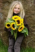 Blond girl with sunflowers