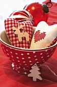Xmas decorations: fabric hearts, wooden tree ornaments, baubles