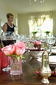 Wine and roses on laid table