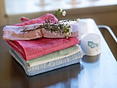 Linen cloths with flowering branch on top