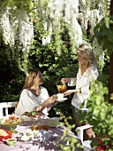 Two women having tea in a garden