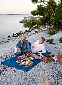 A couple having a picnic on a beach