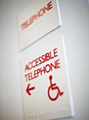 A sign directing you to a hotel's public telephone