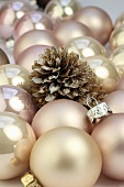 Pink Christmas baubles and a pine cone