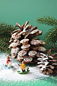 Jazzies on pine cones and small toy figures on rocking horses