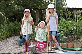Three girls gardening in vegetable garden