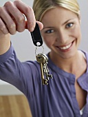 A woman holding keys