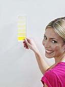 A woman holding a colour chart