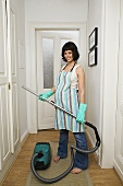 A pregnant woman hoovering