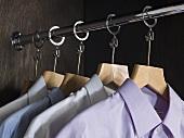 Shirts hanging in a wardrobe