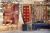 Turkish rugs on wall in simena