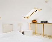 A loft bedroom with a skylight