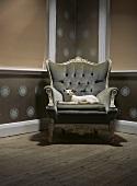 A stuffed cat in an armchair