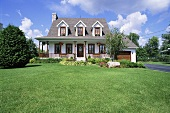 A lawn in front of a large house