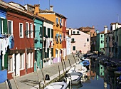 Colourful houses along a canal in Burano