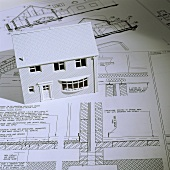 A model house and architectural blueprints