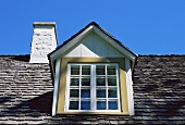 A roof window and a chimney