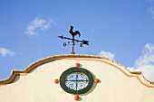 A weather vane on a building