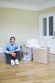 A man in a room with cardboard boxes