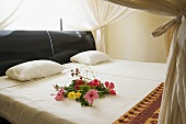 Flowers on a double bed