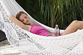 A woman sleeping in a hammock