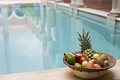 Fruit by a swimming pool