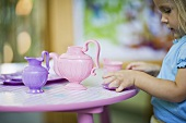 A girl having a tea party