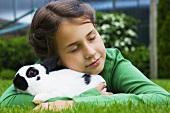 A girl hugging a rabbit
