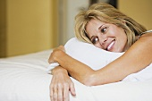 Happy woman on bed