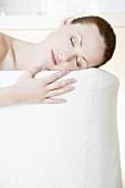 Young woman asleep on a sofa