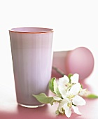 Pink glass vases with apple blossom