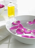 Rose petals floating in a bowl
