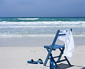 Blue chair by the sea