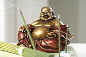 Green tea incense sticks with Buddha figure