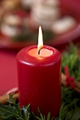 A burning candle on an Advent wreath