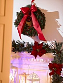 Advent wreath with red bow on a wall