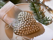 Place-setting with napkin & beaded heart with hanging loop