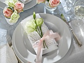Place-setting for special occasion with napkin & lisianthus