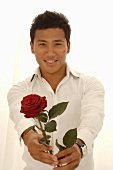 Asian man with red rose