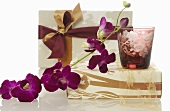 Gifts, windlight and orchid flowers