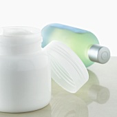 Jar of cream and bottle